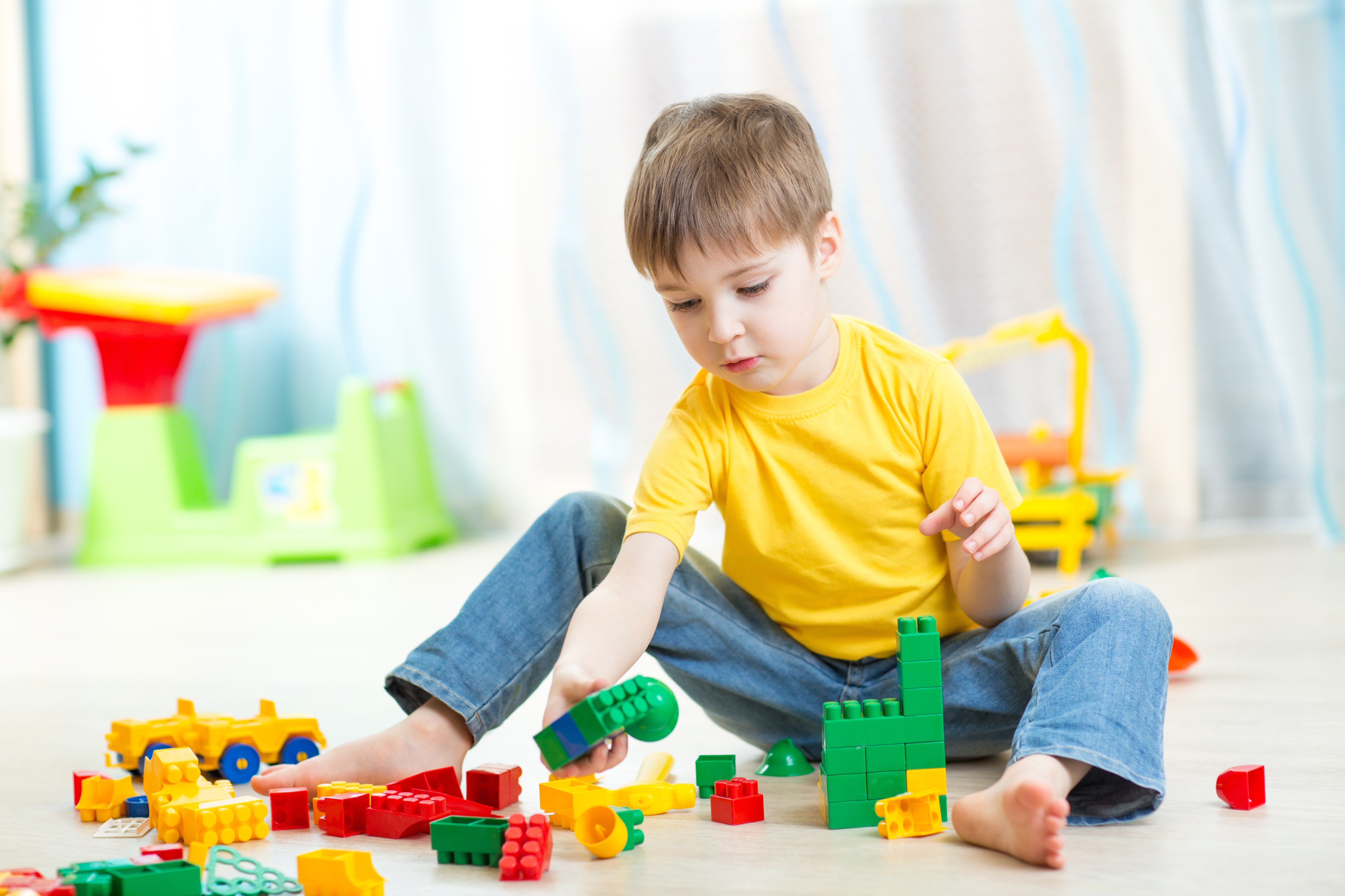 child boy plays on floor in nursery